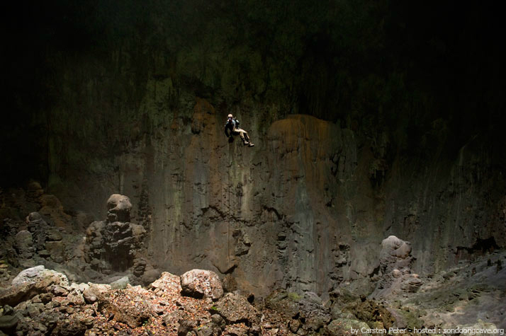 "a climber descends 225 feet by rope into ""Loong Con"" cave"